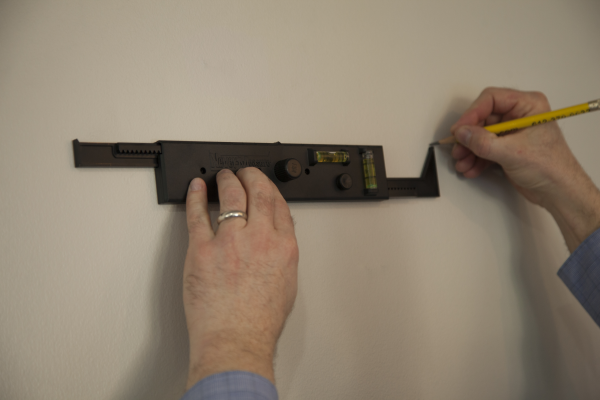 Using NeverMeasure to mark where the fasteners go.